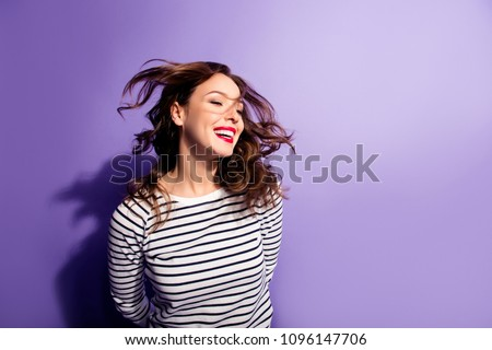 Ha-ha! Portrait with copy space empty place of cheerful laughter funny comic girl having flying hair isolated on violent background, enjoying wind flow