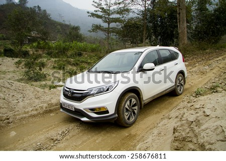 Ha Noi, Viet Nam - Feb 10, 2015: An SUV Honda model CRV 2015 runing on the bad road in Vietnam #258676811
