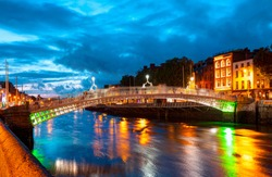 Ha'Penny Bridge at twilight blue hour - Dublin, Ireland.