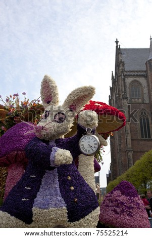 HAARLEM, THE NETHERLANDS - APRIL 17: Alice in Wonderland with flowers at flower parade on April 17 2011 in Haarlem, The Netherlands. The  flower parade is a huge event with one million visitors.