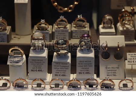 Haarlem, the Netherlands - October 6th 2018: Diamond rings in a shop window. Text on tags: discount prices for going out of business in Dutch, price tags in euros #1197605626