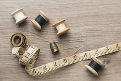 Haberdashery tools and equipment, used for mending and repair. View from above. Wooden rustic background.
