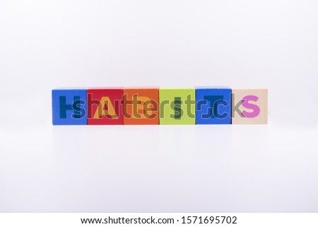 HABITS word made with building colored blocks