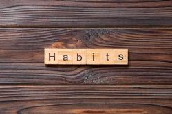 HABITS word written on wood block.