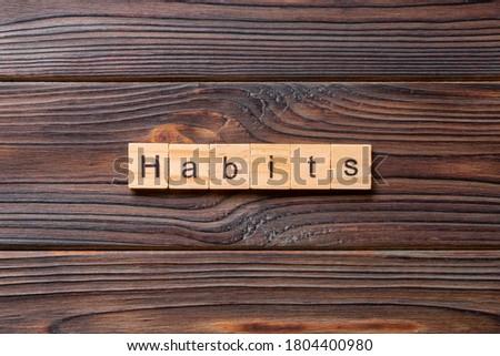 HABITS word written on wood block. Сток-фото ©