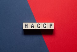 HACCP - Hazard Analysis and Critical Control Points word concept on cubes