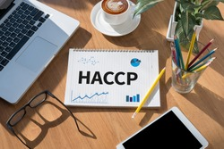 HACCP open book on table and coffee Business