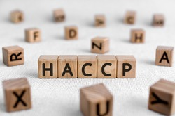 HACCP - words from wooden blocks with letters, Hazard Analysis and Critical Control Points, haccp concept, white background