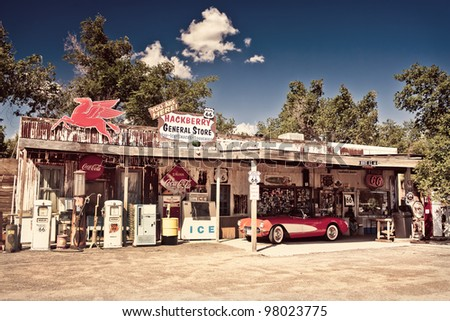 HACKBERRY - JUL 13: Hackberry General Store with a 1957 red Corvette car in front on July 13, 2011 in Hackberry , Arizona, USA. Hackberry General Store is a popular museum of old Route 66