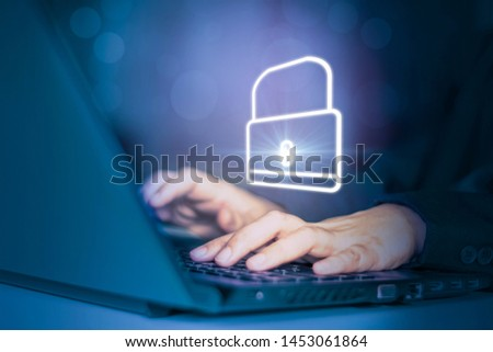 Hacker attack laptop computer with background icon binary and padlock,concept preventing website attacks by keeping financial information with block chain and internet of things(iot)technology