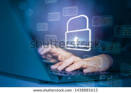 Hacker attack laptop computer with background icon binary, shield and padlock,concept preventing website attacks by keeping financial information with block chain and internet of things(iot)technology