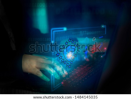Hacker attack laptop computer with background icon binary, shield and padlock,concept preventing website attacks by keeping financial information with block chain technology,cyber security