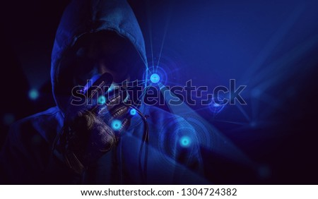 hacker blue hood outfit and mask with glove on dark background in security virus network ai hologram concept, terrorist with dark face, attack on software system server, crime for technology,  gamer