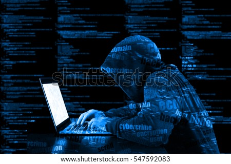 Hacker in a blue hoody standing in front of a code background with binary streams and information security terms cybersecurity concept Stock photo ©
