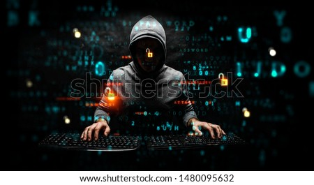 Hacker in hoodie dark theme Stok fotoğraf ©