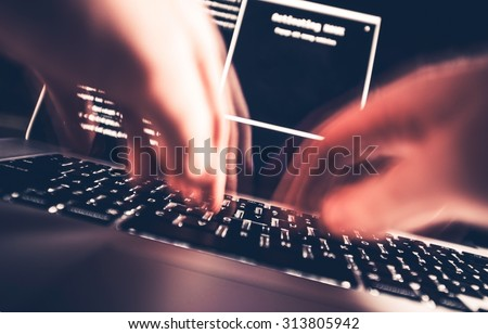 Hacker in Work. High Speed Computer Keyboard Typing by Professional Hacker. Hacking the Internet Photo Concept.