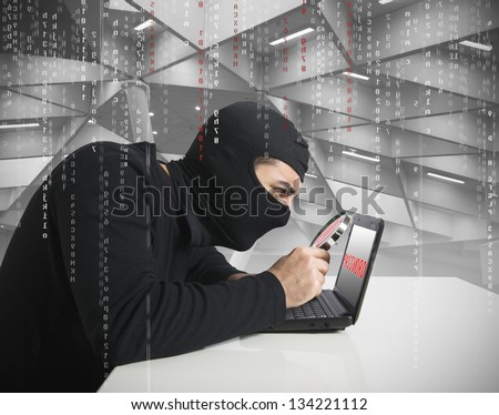 Hacker look for password in a laptop