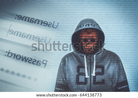 hacker over a screen with binary code and in front of a screen with username and password request fields #644138773