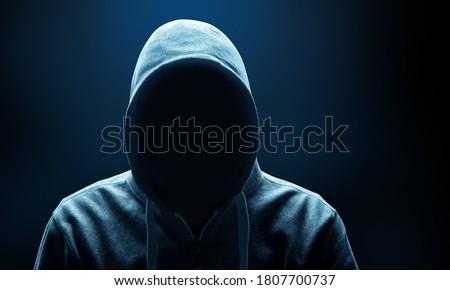 Hacker prints a code on a laptop keyboard to break into a cyberspace Foto stock ©