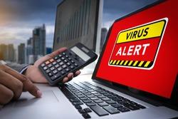 Hacker Protection Concept Man working on laptop Virus Detected Alert Digital Browsing Firewall