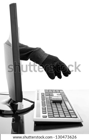 Hacker's gloved hand stealing padlock through a computer screen. Concept of internet security.