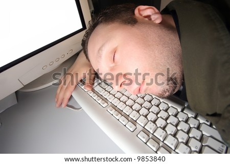 Hacker sleep on his keyboard as on pillow after hard work of hacking some security systems in front of his computer like a baby