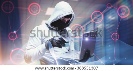 Hacker using laptop to steal identity against abstract glowing black background