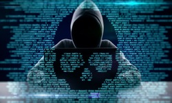 Hacker using laptop with abstract skull shape binary code. Hacking and attack concept. Multiexposure
