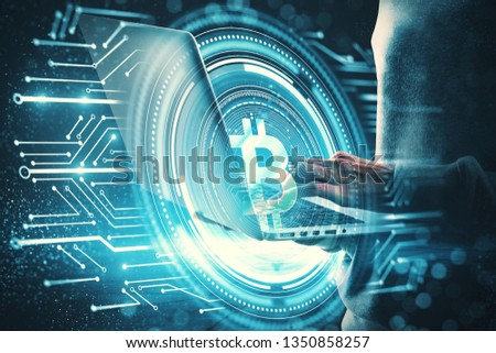 Hacker using laptop with bitcoin circuit on blurry blue background. E-commerce and malware concept. Double exposure  #1350858257