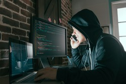 hacker using mobile smartphone calling for victim and stealing personal information through data in order to scamming ransom.