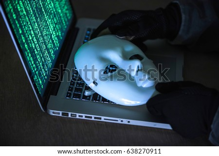 Stock Photo Hacker wear an anonymous mask.