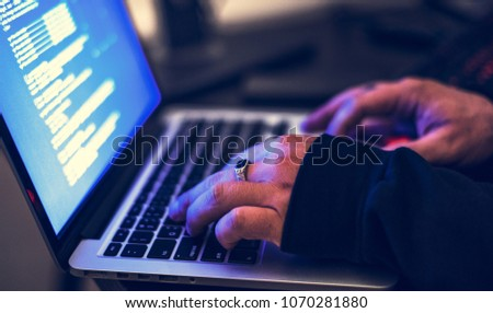 Hacker working on hacking some information
