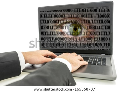 Hacker working on laptop with human eye with digital binary code on screen. Concept of internet surveillance and espionage.