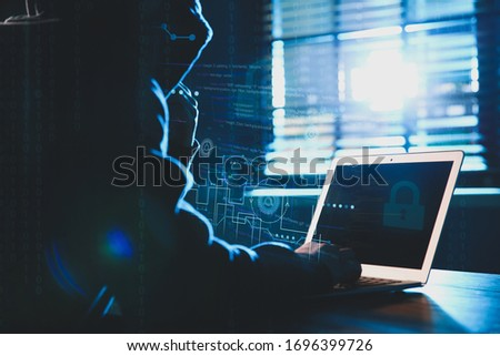 Hacker working with laptop at table indoors. Cyber attack Foto stock ©
