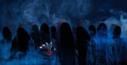 Hackers army. Dangerous hooded group of hackers. Internet, cyber crime, cyber attack, system breaking and malware concept. Dark face. Anonymous. Abstract smoke moves on black background.