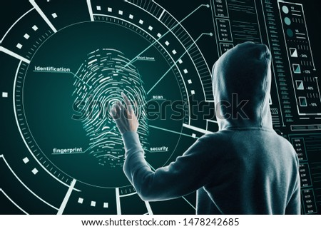 Hacking and security concept with back view hacker pushing on fingerprint on digital screen with cyberspace icons.