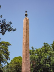 Hadrianic obelisk or Obelisco del Pincio in historical center, Pincian Hill of Rome. Roman obelisk engraved with hieroglyphics, was erected in Tivoli for the tomb of Antinous, order by Emperor Hadrian