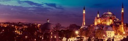 Hagia Sophia - ancient landmark of Istanbul at night for your travel horizontal banner. Panoramic view on Turkish Mosque with minarets. Ayasofya - Orthodox temple of Byzantine in Constantinople.