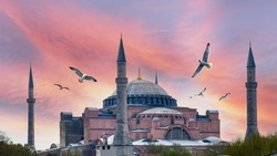 Hagia Sophia is an ancient religion symbol of Istanbul at sunrise. Ayasofya was the greatest Christian temple of Byzantium Empire. Famous Turkish Mosque with foth minarets and birds over the dome.