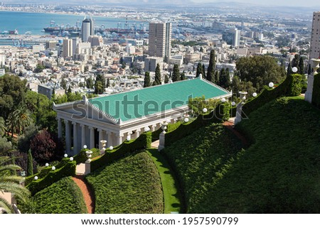 Haifa, Bahai gardens.Harbour view from the top of Carmel mountain. Green roof of bahai temple. Center of Bahaism religion.