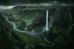 Haifoss waterfall in South Iceland in the dusk. Beautiful nature dramatic moody landscape. Panorama view. Color filter toned