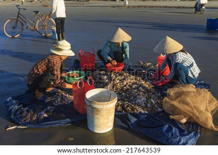 HAIHAU, VIETNAM - AUGUST 10, 2014 - People selling sea food on the beach. This kind of business is very popular in Vietnam, carried out by local inhabitants.