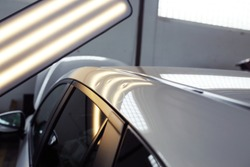 hail damage on a car, lights for detecting dents in a car body