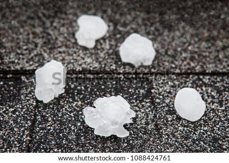 Hail in on roof after hailstorm, shallow focus on hail ball in front