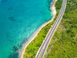 Hainan Island Ring Expressway Coastal Scenery along Perfume Bay (Xiangshui Bay) and Niuling Mountain, Lingshui, Hainan Province, a Tourism Destination for Summer Vacation in China. Aerial View.