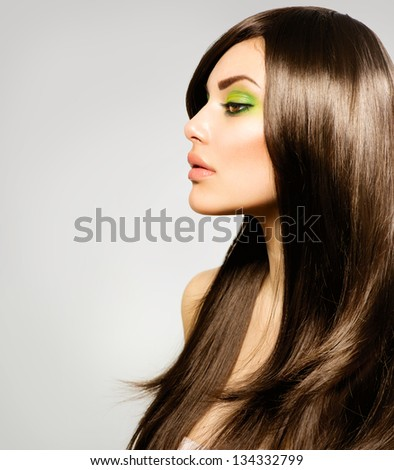 Hair Beautiful Brunette Girl Healthy Long Brown Hair Beauty Model Woman with Green makeup Trendy Spring Make-up