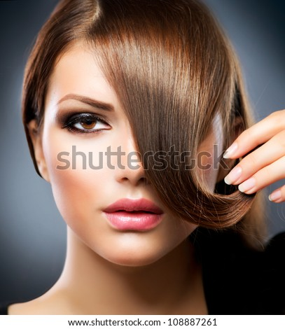 Hair. Beauty Girl With Healthy Long Brown Hair