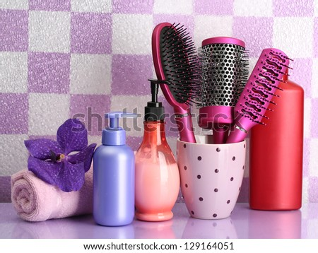 Hair brushes and cosmetic bottles in bathroom