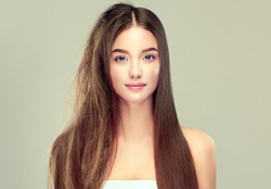 Hair care . Keratin straightening ,smoothing and treatment of the hair .  Girl with straight and smooth hair on one side of the head . The second side of the head tangled and un brushed hair .