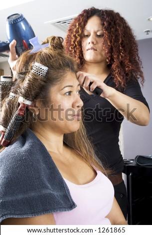 Hair dresser applying rollers 3